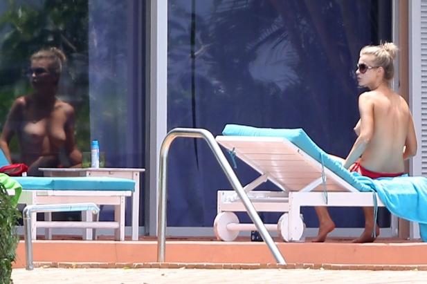 Joanna Krupa topless.